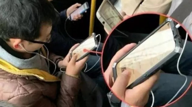 Chinese man holding a smartphone with in-screen selfie camera shocks the world